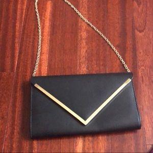 Gold V Black Clutch